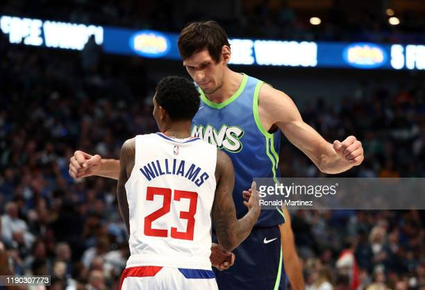 Boban Marjanovic of the Dallas Mavericks and Lou Williams of the Los Angeles Clippers at American Airlines Center on November 26, 2019 in Dallas,...