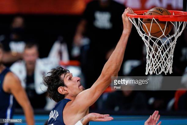 Boban Marjanovic of the Dallas Mavericks dunks the ball against the Phoenix Suns during the first half at Visa Athletic Center at ESPN Wide World Of...