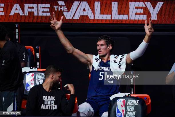 Boban Marjanovic of the Dallas Mavericks reacts from the bench during the first half against the Phoenix Suns at Visa Athletic Center at ESPN Wide...