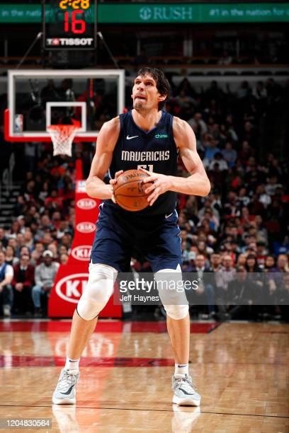Boban Marjanovic of the Dallas Mavericks shoots three point basket against the Chicago Bulls on March 2, 2020 at United Center in Chicago, Illinois....