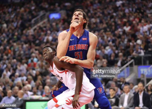 Boban Marjanovic of the Detroit Pistons battles for positioning against Pascal Siakam of the Toronto Raptors in anticipation of a rebound at Air...