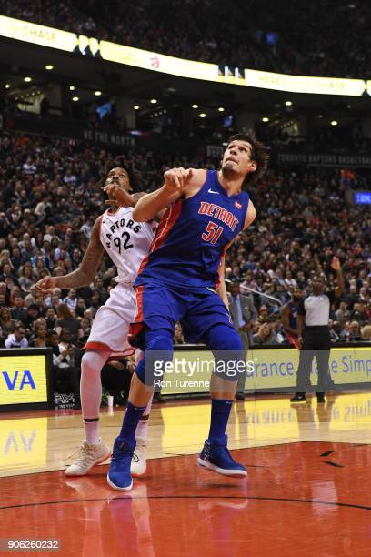 Boban Marjanovic of the Detroit Pistons boxes out against Lucas Nogueira of the Toronto Raptors on January 17 2018 at the Air Canada Centre in...