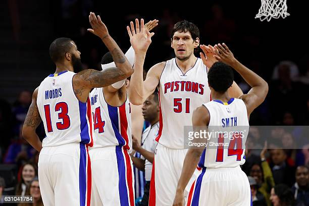 Boban Marjanovic of the Detroit Pistons celebrates a first half play with Ish Smith Marcus Morris and Tobias Harris while playing the Charlotte...