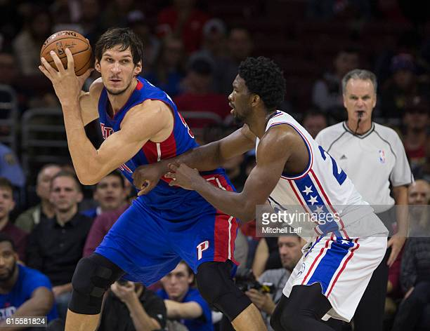 Boban Marjanovic of the Detroit Pistons controls the ball against Joel Embiid of the Philadelphia 76ers at Wells Fargo Center on October 15 2016 in...