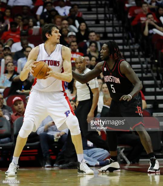 Boban Marjanovic of the Detroit Pistons controls the ball defended by Montreal Harrell of the Houston Rockets in the first half at Toyota Center on...