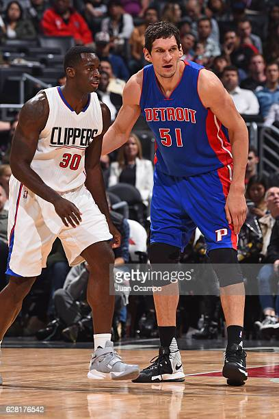 Boban Marjanovic of the Detroit Pistons defends against Brandon Bass of the LA Clippers on November 7 2016 at the STAPLES Center in Los Angeles...