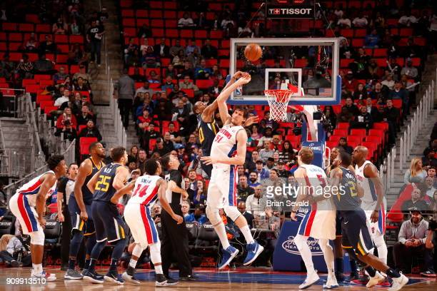 Boban Marjanovic of the Detroit Pistons goes for the jump ball against Alec Burks of the Utah Jazz on January 24 2018 at Little Caesars Arena in...