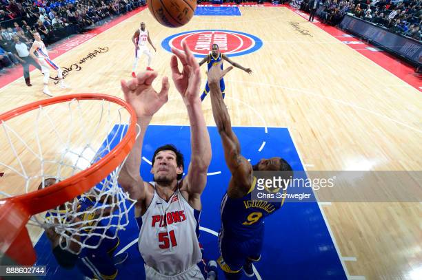 Boban Marjanovic of the Detroit Pistons goes to the basket against the Golden State Warriors on December 8 2017 at Little Caesars Arena in Detroit...