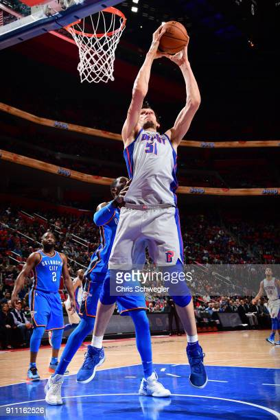 Boban Marjanovic of the Detroit Pistons grabs the rebound against the Oklahoma City Thunder on January 27 2018 at Little Caesars Arena in Detroit...