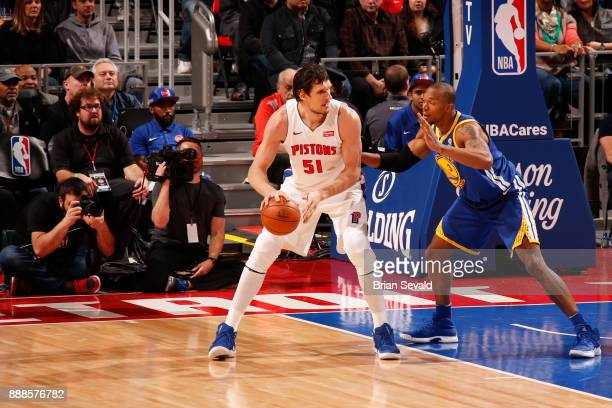Boban Marjanovic of the Detroit Pistons handles the ball against the Golden State Warriors on December 8 2017 at Little Caesars Arena in Detroit...