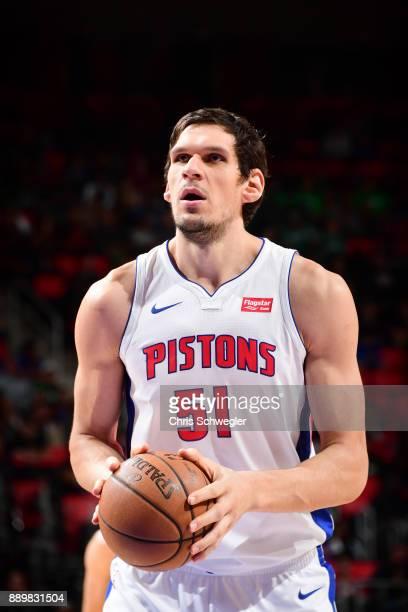 Boban Marjanovic of the Detroit Pistons handles the ball against the Boston Celtics on December 10 2017 at Little Caesars Arena in Detroit Michigan...