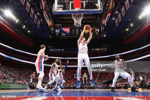 Boban Marjanovic of the Detroit Pistons handles the ball against the Denver Nuggets on December 12 2017 at Little Caesars Arena in Detroit Michigan...