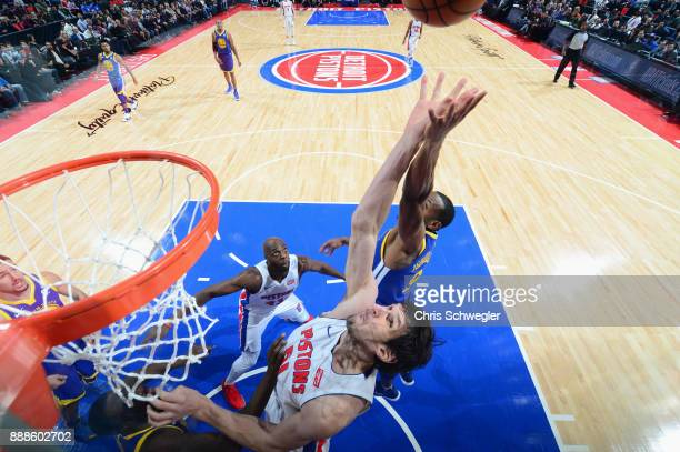 Boban Marjanovic of the Detroit Pistons jumps for the rebound against the Golden State Warriors on December 8 2017 at Little Caesars Arena in Detroit...