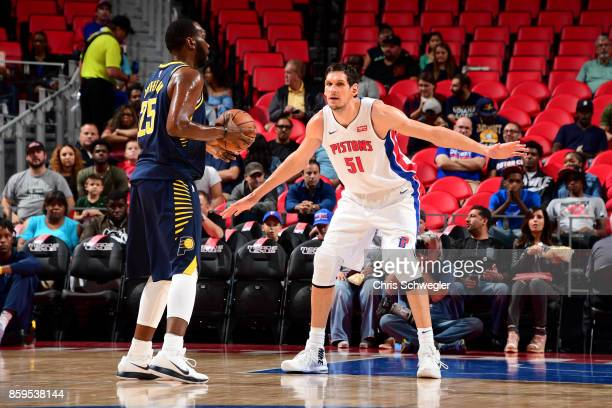 Boban Marjanovic of the Detroit Pistons plays defense against the Indiana Pacers on October 9 2017 at Little Caesars Arena in Detroit Michigan NOTE...