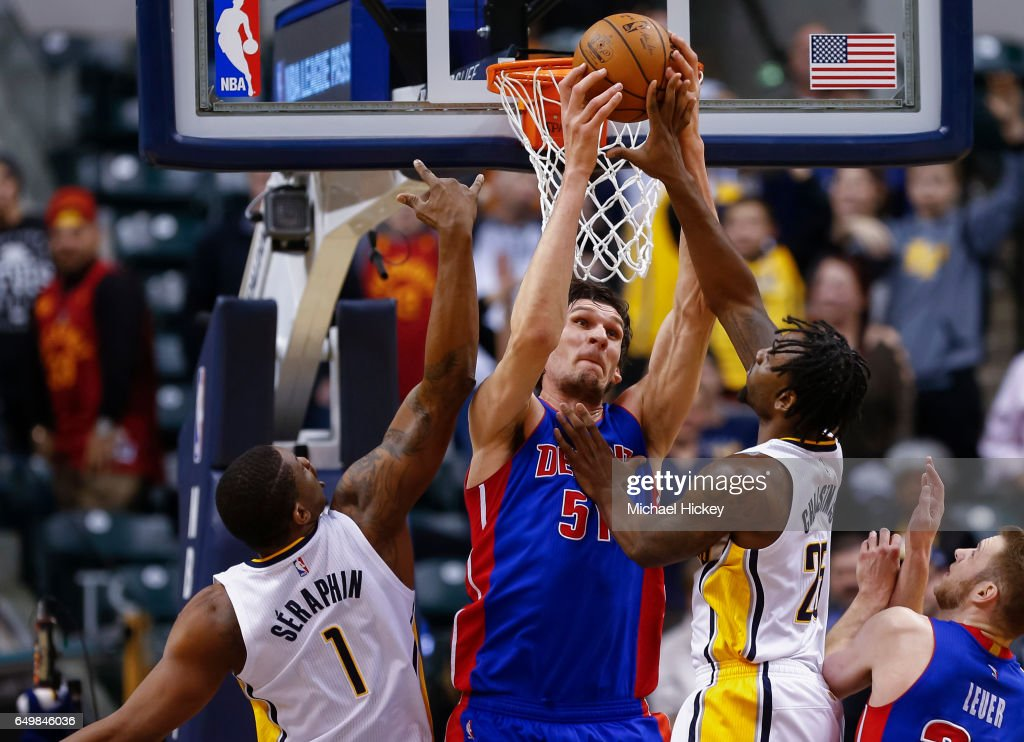Boban Marjanovic #51 of the Detroit Pistons reaches for the rebound against Kevin Seraphin #1 and Rakeem Christmas #25 of the Indiana Pacers at Bankers Life Fieldhouse on March 8, 2017 in Indianapolis, Indiana.
