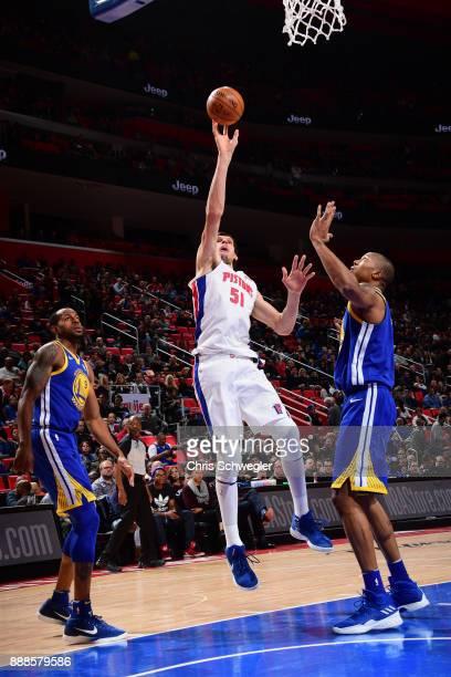 Boban Marjanovic of the Detroit Pistons shoots the ball against the Golden State Warriors on December 8 2017 at Little Caesars Arena in Detroit...