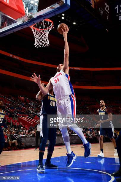 Boban Marjanovic of the Detroit Pistons shoots the ball against the Denver Nuggets on December 12 2017 at Little Caesars Arena in Detroit Michigan...