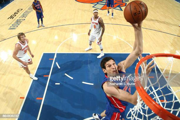 Boban Marjanovic of the Detroit Pistons shoots the ball during a game against the New York Knicks at Madison Square Garden in New York City New York...