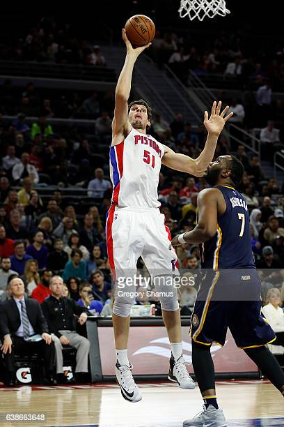 Boban Marjanovic of the Detroit Pistons takes a second half shot behind Al Jefferson of the Indiana Pacers at the Palace of Auburn Hills on January 3...