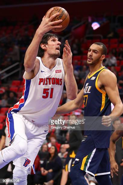 Boban Marjanovic of the Detroit Pistons takes a shot next to Rudy Gobert of the Utah Jazz during the first half at Little Caesars Arena on January 24...