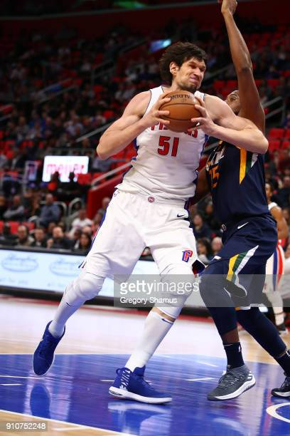 Boban Marjanovic of the Detroit Pistons tries to get a shot off while playing the Utah Jazz at Little Caesars Arena on January 24 2018 in Detroit...