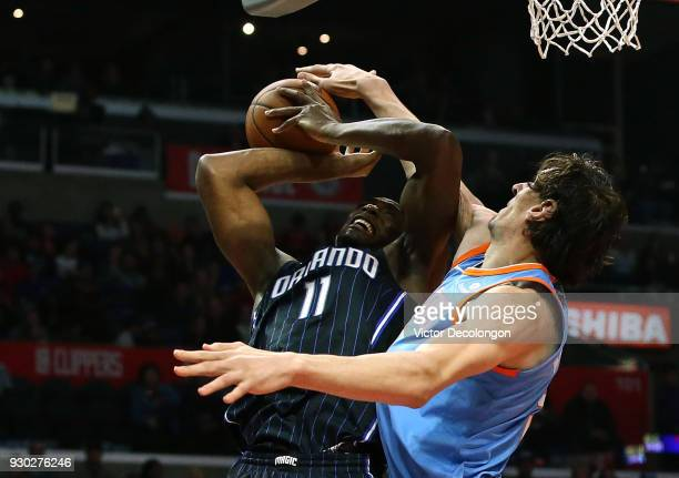 Boban Marjanovic of the Los Angeles Clippers blocks a shot by Bismack Biyombo of the Orlando Magic during the second half of the NBA game between the...