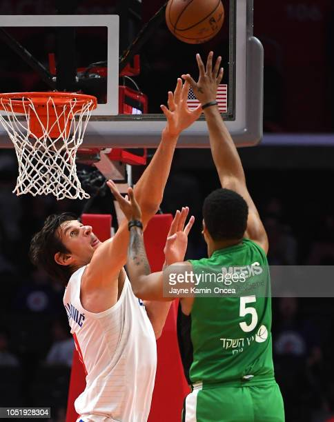 Boban Marjanovic of the Los Angeles Clippers blocks a shot by Kennedy Meeks of Maccabi Haifa in the first half of the game at Staples Center on...