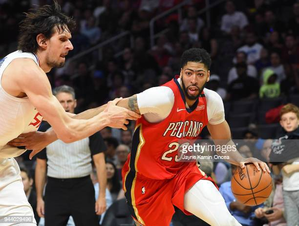 Boban Marjanovic of the Los Angeles Clippers fouls Anthony Davis of the New Orleans Pelicans s he drives to the basket in the second half of the game...