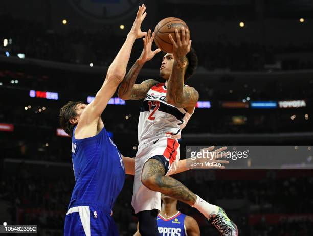 Boban Marjanovic of the Los Angeles Clippers guards Kelly Oubre Jr #12 of the Washington Wizards as he shoots the ball in the second half at Staples...