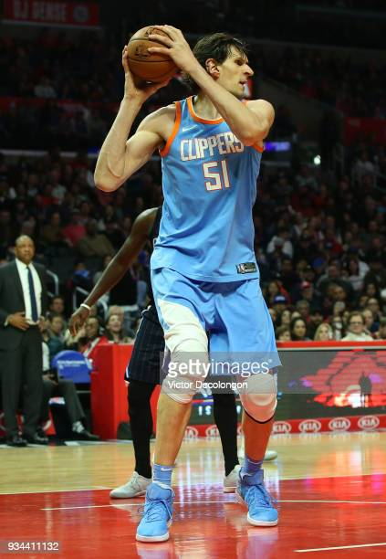 Boban Marjanovic of the Los Angeles Clippers looks to make a pass play during the NBA game between the Orlando Magic and the Los Angeles Clippers at...