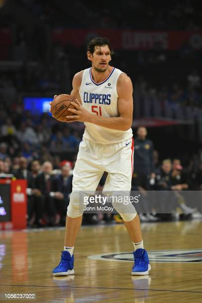Boban Marjanovic of the Los Angeles Clippers looks to pass the ball against the Denver Nuggets during the season opening game at Staples Center on...