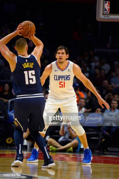 Boban Marjanovic of the Los Angeles Clippers plays against Nikola Jokic of the Denver Nuggets on October 9 2018 at STAPLES Center in Los Angeles...