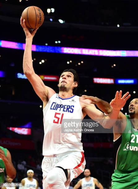 Boban Marjanovic of the Los Angeles Clippers takes goes for a dunk in the game Maccabi Haifa at Staples Center on October 11 2018 in Los Angeles...