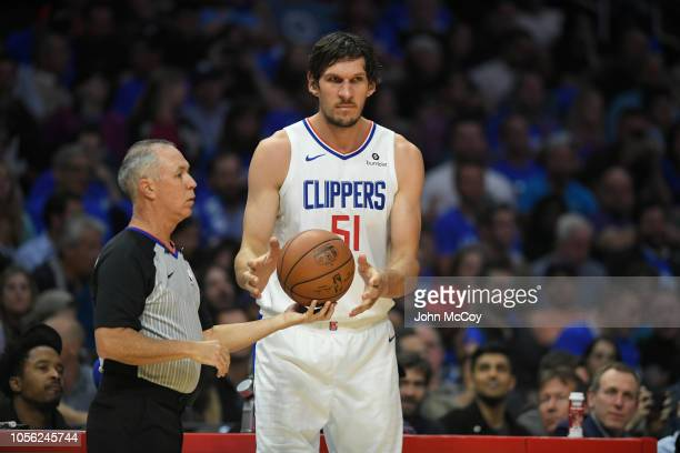 Boban Marjanovic of the Los Angeles Clippers takes the ball from a referee during the season opening game at Staples Center on October 17 2018 in Los...