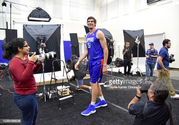 Boban Marjanovic of the Los Angeles Clippers walks through different photo stations on media day at the Los Angeles Clippers Training Center on...