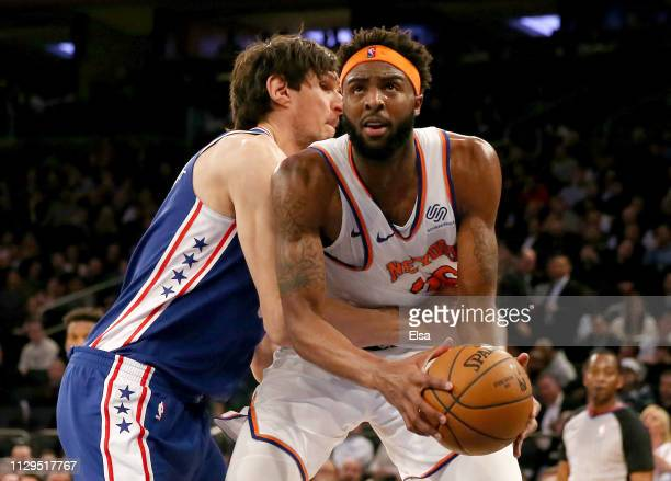 Boban Marjanovic of the Philadelphia 76ers defends as Mitchell Robinson of the New York Knicks heads for the net at Madison Square Garden on February...