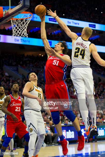 Boban Marjanovic of the Philadelphia 76ers dunks the ball against Nikola Jokic and Mason Plumlee of the Denver Nuggets in the second quarter at the...