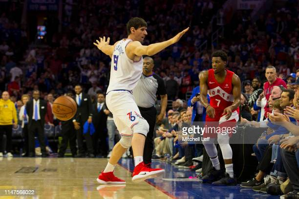 Boban Marjanovic of the Philadelphia 76ers guards Kyle Lowry of the Toronto Raptors on an inbound pass in Game Four of the Eastern Conference...