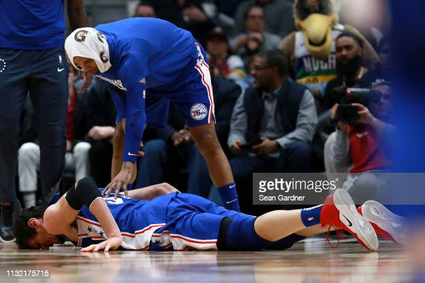 Boban Marjanovic of the Philadelphia 76ers is injured during the second half of a game against the New Orleans Pelicans at the Smoothie King Center...