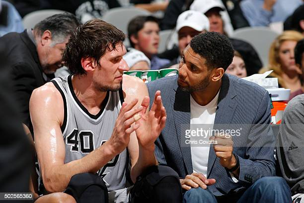 Boban Marjanovic of the San Antonio Spurs and Tim Duncan of the San Antonio Spurs talk during the game against the Denver Nuggets on December 26 2015...