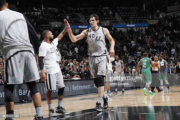 Boban Marjanovic of the San Antonio Spurs celebrates during the game against the Dallas Mavericks on December 17 2016 at the ATT Center in San...