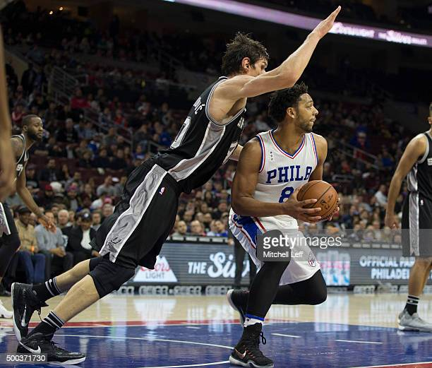 Boban Marjanovic of the San Antonio Spurs defends Jahlil Okafor of the Philadelphia 76ers on December 7 2015 at the Wells Fargo Center in...