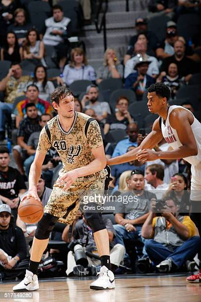 Boban Marjanovic of the San Antonio Spurs defends the ball against the Miami Heat during the game on March 23 2016 at ATT Center in San Antonio Texas...