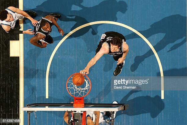 Boban Marjanovic of the San Antonio Spurs dunks the ball during the game against the Minnesota Timberwolves on March 8 2016 at Target Center in...