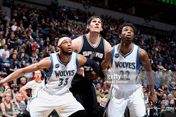 Boban Marjanovic of the San Antonio Spurs fights for the position against Adreian Payne and Andrew Wiggins of the Minnesota Timberwolves during the...