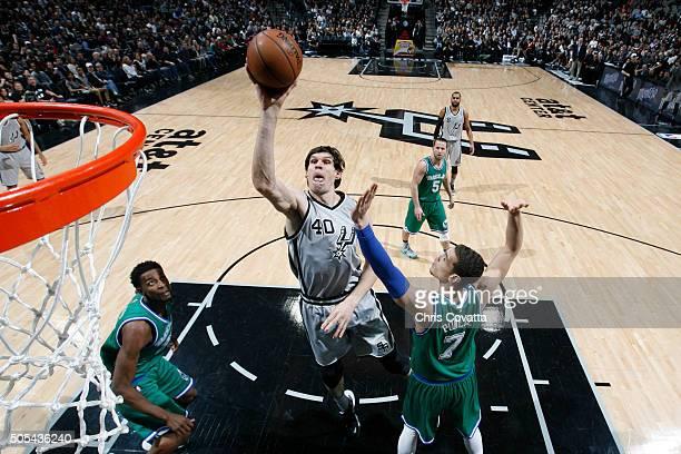 Boban Marjanovic of the San Antonio Spurs goes to the basket against the Dallas Mavericks on December 17 2016 at the ATT Center in San Antonio Texas...