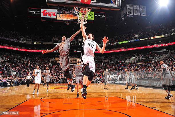 Boban Marjanovic of the San Antonio Spurs goes up for a dunk against Archie Goodwin of the Phoenix Suns on January 21 2016 at Talking Stick Resort...