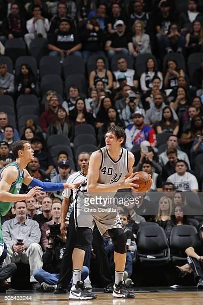Boban Marjanovic of the San Antonio Spurs handles the ball against the Dallas Mavericks on December 17 2016 at the ATT Center in San Antonio Texas...