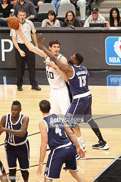 Boban Marjanovic of the San Antonio Spurs handles the ball against Nazr Mohammed of the Oklahoma City Thunder in Game One of the Western Conference...