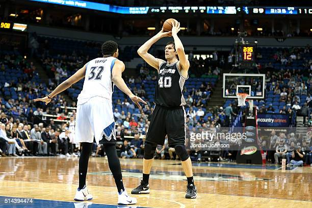 Boban Marjanovic of the San Antonio Spurs handles the ball during the game against the Minnesota Timberwolves on March 8 2016 at Target Center in...